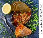fish in tomato sauce in metal...