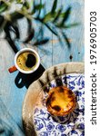 Small photo of Pastel de Nata Fresh baked Portuguese egg custard Tart and Coffee on blue wooden table