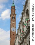 high bell tower of the Basilica Palladiana the most famous monument in the city of Vicenza with the flags flying during the Italian Republic day