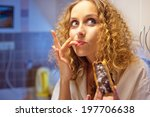 Funny Young Woman Eating Sweet...
