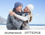 Attractive Couple Hugging On...
