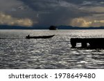 The Silhouette Of A Boat...