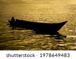 The Silhouette Of A Fishing...