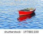 Boat On Water With Red Vivid...