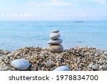beach landscape. cairn on small ... | Shutterstock . vector #1978834700