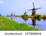 Dutch Windmills With Canal...