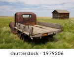 A Rusty Old Pickup Truck And...