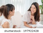 two korean friends chatting and ...   Shutterstock . vector #197922428