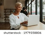happy businesswoman in a cafe...   Shutterstock . vector #1979358806