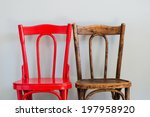 pair of red and brown chairs on ...