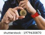 golden bitcoin in a businessman ... | Shutterstock . vector #1979630870