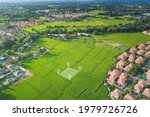 Land plot in aerial view. Identify registration symbol of vacant area for map. That property, real estate for business of home, house or residential i.e. development, sale, buy, purchase or investment