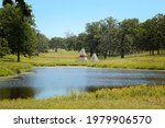 """Teepee""""s Behind A Lake In..."""