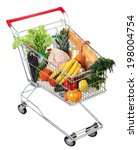 filled shopping trolley, grocery trolley filled with food, isolated image on white background - stock photo