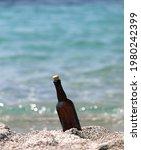 Glass Bottle Stranded On The...