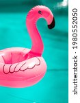 Small photo of Pink flamingo floater on a swimming pool