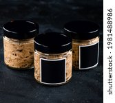 Small photo of Babaganush or eggplant caviar from baked eggplant, babaganush in a jar on a dark background, eggplant babaganush (eggplant puree)