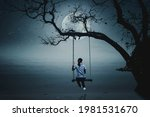 A Girl Sitting On A Swing ...