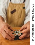 chef's male hands making sushi...   Shutterstock . vector #1981556723