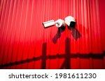 A White Cctv Camera Mounted...