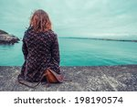 a young woman is sitting by the ... | Shutterstock . vector #198190574