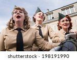 Small photo of SAINTE-MERE-EGLISE, FRANCE - JUNE 6, 2014:Three female American singers performing as part of a World War II reenactment in commemoration of the 70th anniversary of D-Day.