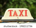 Taxi Sign On The Roof Red And...