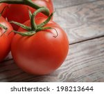 fresh tomatoes on rustic wooden ... | Shutterstock . vector #198213644