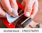 Guitar Master Polishing Frets...