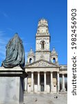 Small photo of Portsmouth,England. May 30th 2021. Statue of queen Victoria looks toward the Guildhall building and Guildhall square.