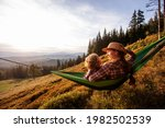 Boy With Mom Resting In A...