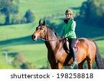 Stock photo woman riding a horse 198258818