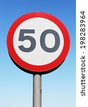 Small photo of Fifty miles per hour speed limit sign against a blue sky background.