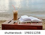 Book At Beach Table And Coffee...