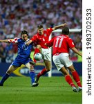 Small photo of LISBON, PORTUGAL - JUNE 21, 2004: Tomo Sokota and Steven Gerrard in action during the UEFA Euro 2004 Croatia vs England at the Estadio da Luz.
