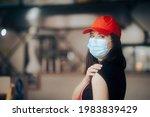 fast food employee wearing face ... | Shutterstock . vector #1983839429