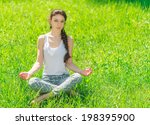 young woman sitting in a lotus... | Shutterstock . vector #198395900