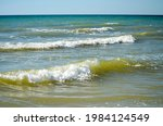 Waves With Foaming Crests At...