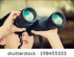Boy Looking Through Binoculars. ...
