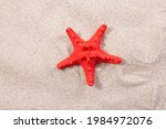 Red Starfish On The Sand Close...