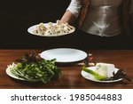 waiter brings a plate of...   Shutterstock . vector #1985044883