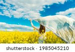 beautiful woman with wind... | Shutterstock . vector #1985045210