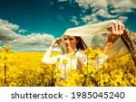 beautiful woman with wind... | Shutterstock . vector #1985045240