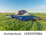 hot air balloon has landed in a ... | Shutterstock . vector #1985059886