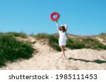 Girl With Bag And Rubber Ring...