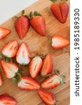 Small photo of A group of red berries, sliced lengthwise