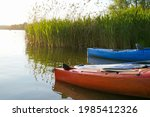 kayaks on the lake near reeds...   Shutterstock . vector #1985412326