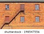 Brick Facade With Windows And...