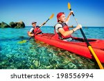 two men paddle a kayak on the... | Shutterstock . vector #198556994