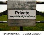 A Sign On A Gate Says  Private...